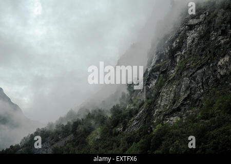 View of low lying clouds on the Fjords in Grainger, Norway.  Credit: Euan Cherry - Stock Photo