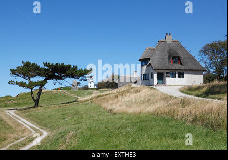 The home of the famous Danish polar explorer and anthropologist, Knud Rasmussen, on the moraine cliff Spodsbjerg - Stock Photo