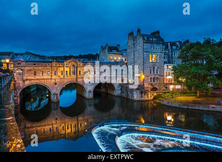 Night shot of the historic 18thC Pulteney Bridge over the River Avon in the historic city centre, Bath, Somerset, - Stock Photo