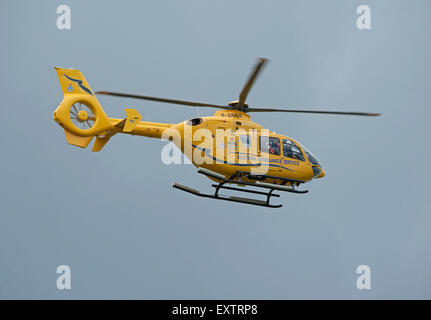 Eurocopter EC135T-1 G-SASA Departing Inverness Dalcross Airport Base on callout.  SCO 9960. - Stock Photo