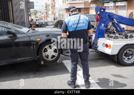 illegally parked car being towed away by Police in Canary Islands - Stock Photo