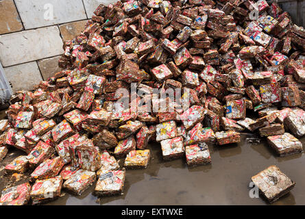 Recycling yard in Hamburg, pressed beverage cans - Stock Photo