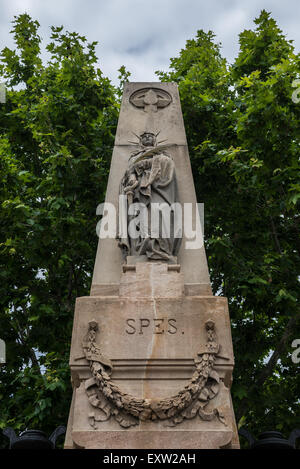 Statue at the entry to Poblenou Cemetery - Cementiri de l'Est (East cemetery) in Barcelona, Spain - Stock Photo