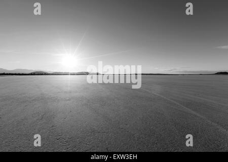 Afternoon sun at El Mirage dry lake bed in California's Mojave desert. - Stock Photo