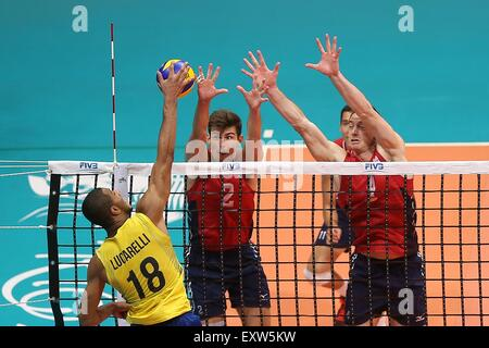 Rio De Janeiro, Brazil. 16th July, 2015. Russell Aaron (C) and Lee David (R) of the United States block the ball - Stock Photo
