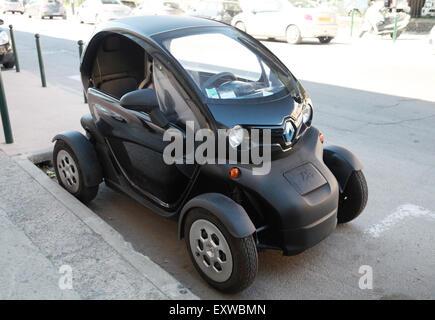 Ajaccio, France - June 30, 2015: Black Renault Z.E. all-electric car on the roadside in Ajaccio, Corsica island - Stock Photo