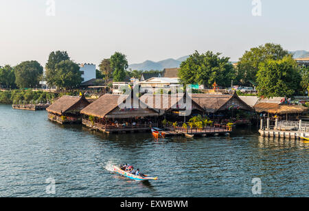 Longtail boat in front of floating houses, River Kwai, Kanchanaburi Province, Central Thailand, Thailand - Stock Photo