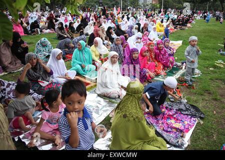 Manila, Philippines. 17th July, 2015. Filipino Muslims gather at the Quirino Grandstand in Manila to celebrate Eid - Stock Photo