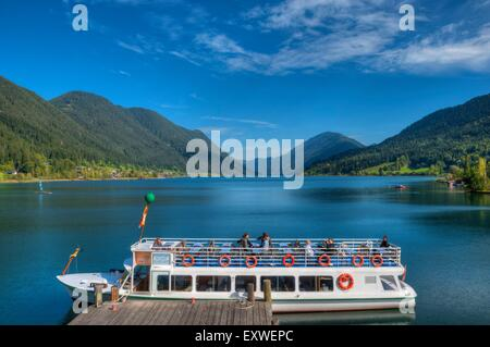Tour boat with Weissensee, Carinthia, Austria - Stock Photo