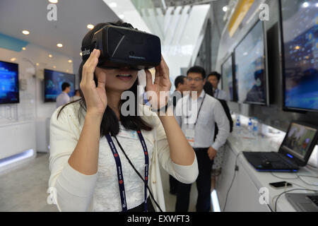 Shanghai, China. 17th July, 2015. A visitor experiences a 3D simulation equipment during the Mobile World Congress - Stock Photo
