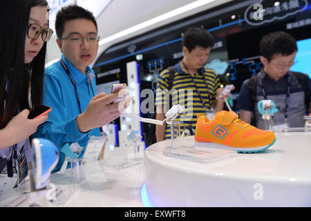 Shanghai, China. 17th July, 2015. People take photos of a children's shoe which has the function of trace during - Stock Photo