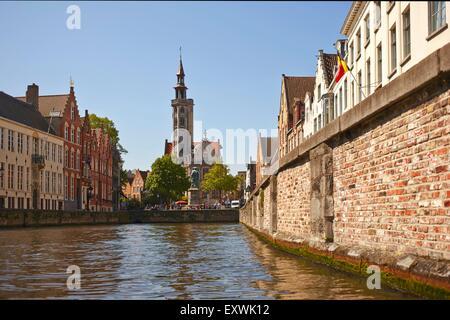 Jan van Eyck Statue and channel in Bruges, Belgium - Stock Photo