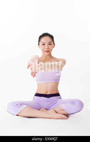 Woman practicing yoga with one leg in the air, - Stock Photo