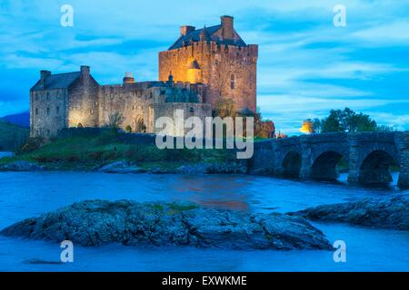 Eilean Donan Castle at dusk at Loch Duich, Scotland - Stock Photo