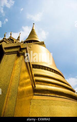 Golden Stupa in Temple Wat Phra Kaeo in Bangkok, Thailand - Stock Photo