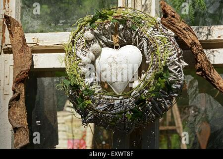 Floral wreath with heart - Stock Photo