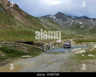 Off-road vehicle, Col de Sommeiller, Cottian Alps, West Alps, Piemont, Italy, Europe - Stock Photo