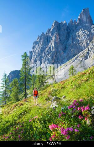 Woman hiking at the Hochkoenig, Berchtesgaden Alps, Austria - Stock Photo