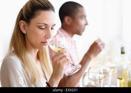 Man and woman tasting white wine - Stock Photo