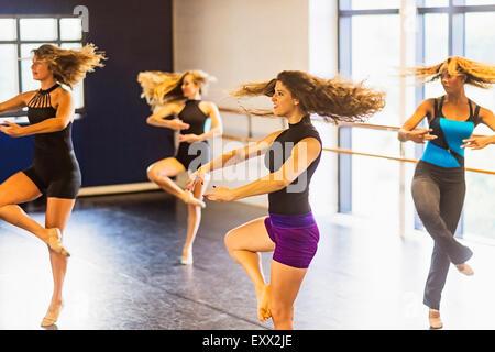 Dancers practicing in dance studio - Stock Photo