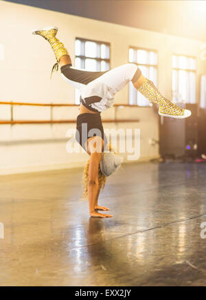 Young woman dancing in dance studio - Stock Photo