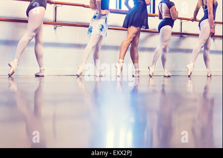 Young women dancing in dance studio - Stock Photo