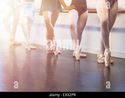 Young women dancing in dance studio - Stock Photo