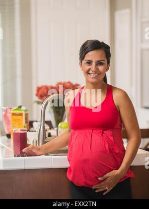 Portrait of pregnant woman smiling - Stock Photo