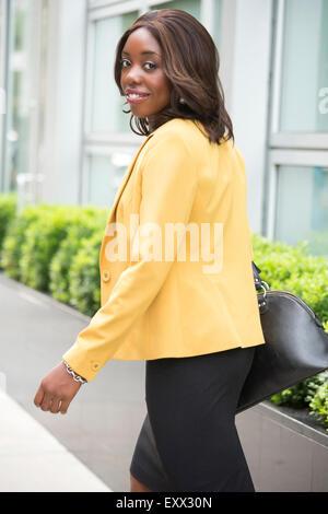 Smiling woman wearing elegant clothes - Stock Photo