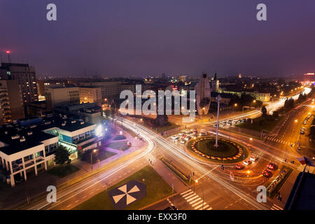Road intersection at night - Stock Photo