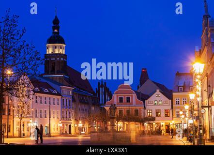Altmarkt and St. Nikolai Church illuminated at night - Stock Photo