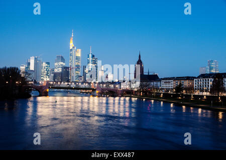 Illuminated skyline at dusk - Stock Photo