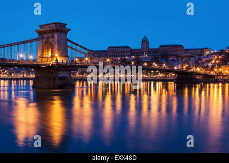 Illuminated Chain Bridge and Buda skyline - Stock Photo