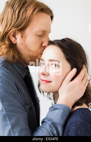 Man kissing young woman - Stock Photo