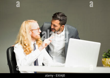 Businessmen talking in office - Stock Photo