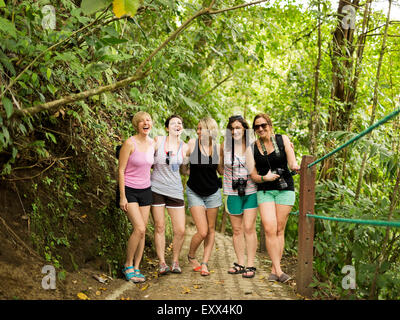 Young women on footpath in forest - Stock Photo