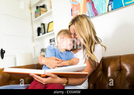 Mother reading book to son (4-5) - Stock Photo