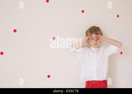 Little boy covering eyes with his hands, portrait - Stock Photo