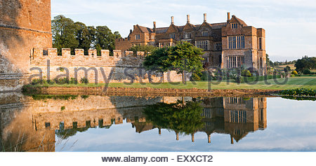 Broughton castle in the evening summer sunlight. Near Banbury, Oxfordshire, England. Panoramic - Stock Photo