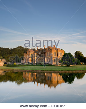 Broughton castle in the evening summer sunlight. Near Banbury, Oxfordshire, England - Stock Photo