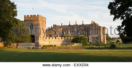 Broughton castle in the evening summer sunlight. Near Banbury, Oxfordshire, England - Stock Photo