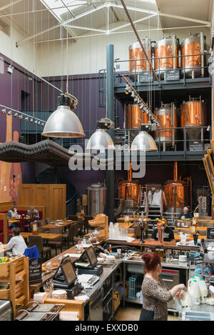 Inside a micro brewery brewing real ale craft beer in Greenwich, London, England, UK - showing the copper vats and - Stock Photo