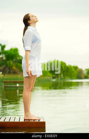 Woman getting away from it all - Stock Photo