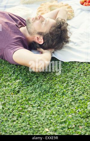 Man napping after picnic - Stock Photo