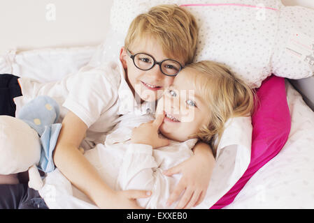 Boy hugging little sister - Stock Photo