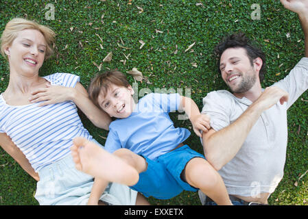 Young family enjoying carefree afternoon playing together - Stock Photo