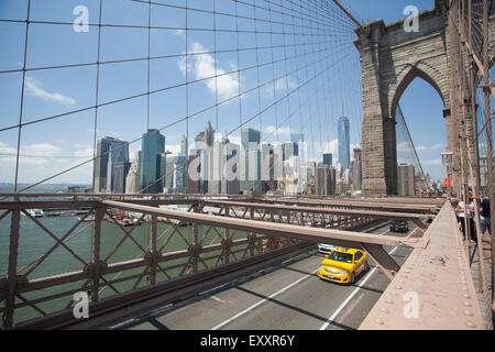 NEW YORK - May 30, 2015: View of lower Manhattan from the Brooklyn Bridge. - Stock Photo