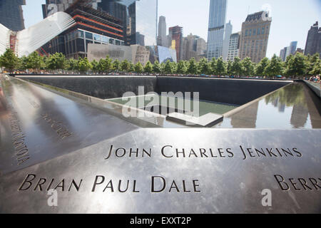 NEW YORK - May 30, 2015: Freedom Tower in Lower Manhattan and the Memorial. One World Trade Center is the tallest - Stock Photo