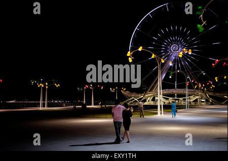 View Baku Ferris Wheel, also known as the Baku Eye on Baku Boulevard in the Seaside National Park of Baku capital - Stock Photo