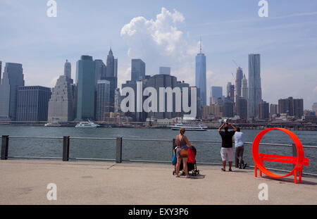 NEW YORK - May 28, 2015: Tourists admiring and taking pictures of Manhattan skyline from Brooklyn. - Stock Photo